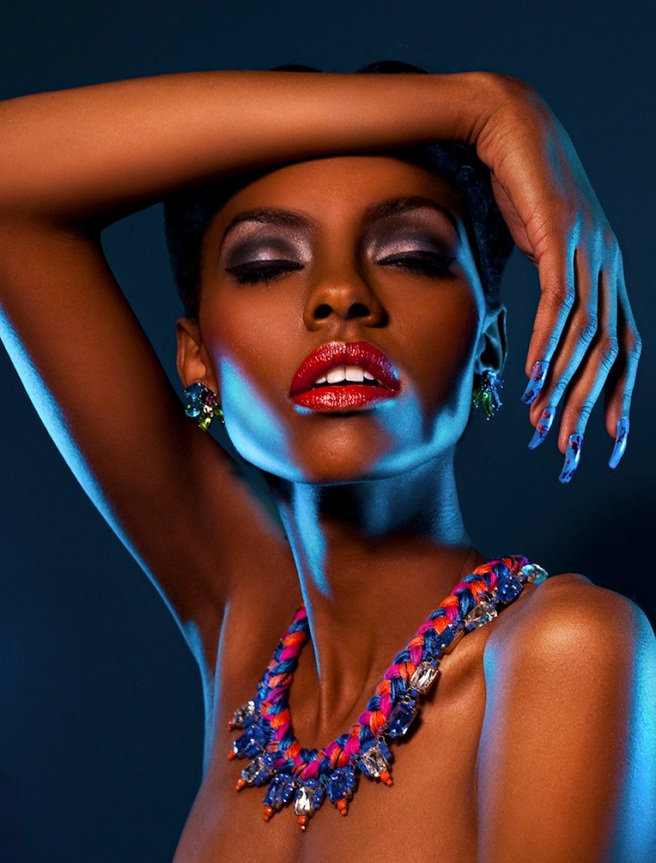 A model is posing for a Noir Saveur shoot in Amsterdam necklace and colourful Ipanima clip-on earrings by Jolita Jewellery