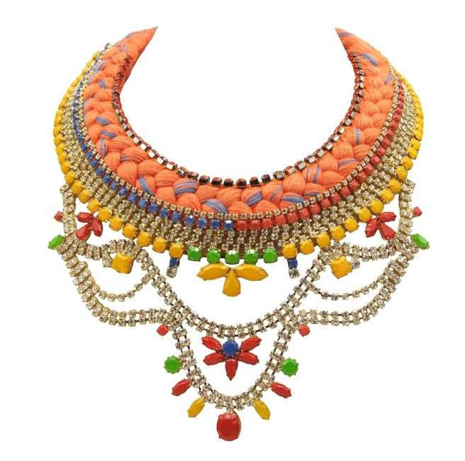 This colourful statement necklace is made with orange silk braid, mixing in a touch of lavender blue. The braid is embellished with a row of small orange crystals, stitched to the top of the braid and a beautiful crystal necklace, hand-painted in yellow, green, red and blue. The crystals are dipped in gold for luxury rich finish.