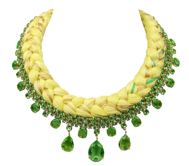 A colourful braided statement necklace in yellow silk, mixing in a touch of green and metallic gold, made with green Bohemian glass rhinestones dipped in gold