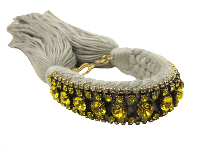 This bracelet is handmade with a double grey silk braid and embellished with a row of citrine yellow crystals.