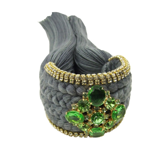 Colourful braided cuff handmade with a grey silk braid and embellished with small crystals and a green buttonnier dipped in 18k gold