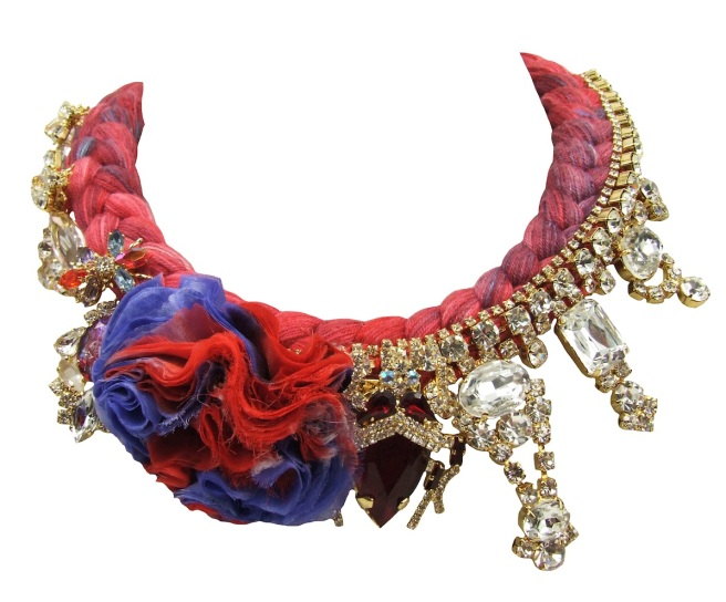 A luxuriou statement necklace made with a scarlet red silk braid, splashed with turquoise, a handmade silk flower and various rhinestones, some in a shape of bugs, dipped in gold