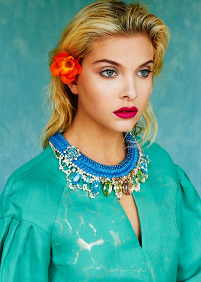 Kit Magazine July issue - a model is wearing Jolita Jewellery's luxury Florence statement necklace, made with a double silk braid in blue, embellished with three rows of small blue crystals and adorned with array of dipped in gold deconstructed colourful jewels.