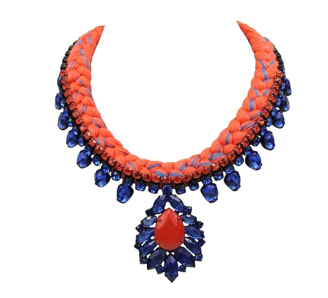 This beautiful handmade statement necklace is made with orange braid silk, mixing in a touch of cobalt blue, hand-dyed by the designer in his London studio. The necklace is embellished with a row of small crystals in orange and adorned with a beautiful cobalt blue crystal necklace. Secures at the back with a lobster clasp and a chain.