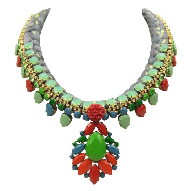 Madrid Lux statement necklace is made with a charcoal silk braid, mixing in a touch of chartreuse  and metallic green silks. The necklace is embellished with a row of opaque green crystals and adorned with a crystal necklace, hand-painted in various shades of pastel green, blue and red, also decorated with a small red coral flower.