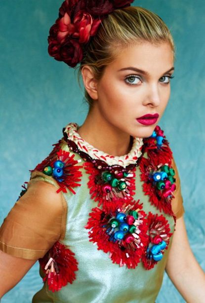 Kit Magazine July issue - a model is wearing Jolita Jewellery's Paris statement necklace, made with red crystals and a thick silk braid in cream and red.