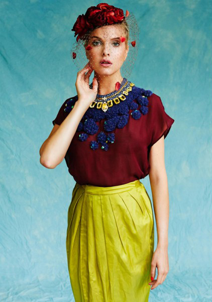 Kit Magazine July issue - a model is wearing Jolita Jewellery's luxury Portofino statement necklace, made with a double silk braid in charcoal colour, embellished with a gold tone chain and an array of dipped in gold deconstructed citrine colour jewels