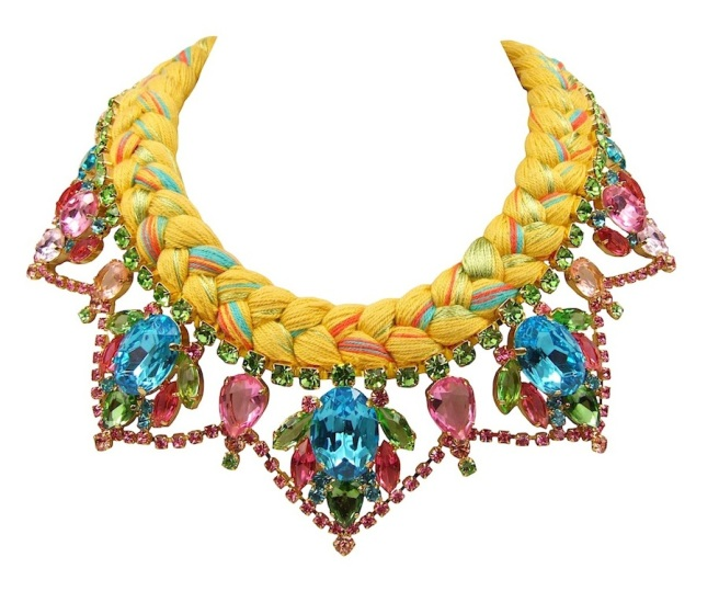 A colourful statement necklace made with dipped in gold crystals and silk braid in mustard and pastel colours purple, green, red and mixing in a touch of neon light blue.