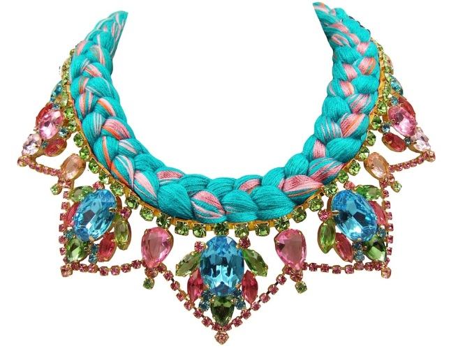 A bright colourful statement necklace made with dipped in gold crystals and silk braid in vivid turquoise mixing in a touch of orange and various shades of pink.
