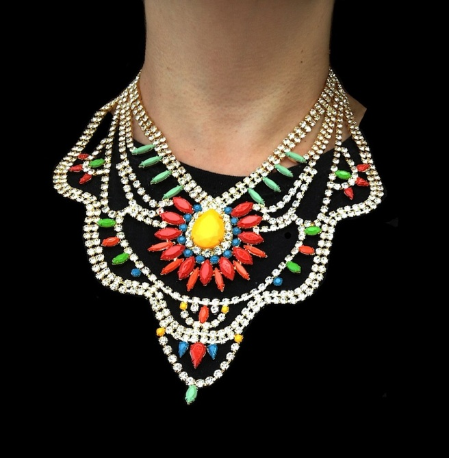 Tangier statement necklace by Jolita Jewellery is made with clear crystals, dipped in gold. Some of the crystals are hand-painted in an array of colours with a beautiful red flower positioned at the centre.