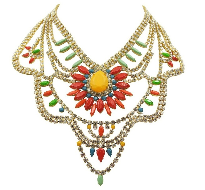 Tangier statement necklace is made with clear crystals, dipped in gold. Some of the crystals are hand-painted in an array of colours with a beautiful red flower positioned at the centre.