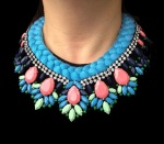 This colourful statement necklace is made with a silk braid in blue, achieved by mixing up to 6 various pigments to form a truly unique colour. The silk braid is embellished with beautiful crystals, hand-painted in pastel blue, green, pink and dark purple.