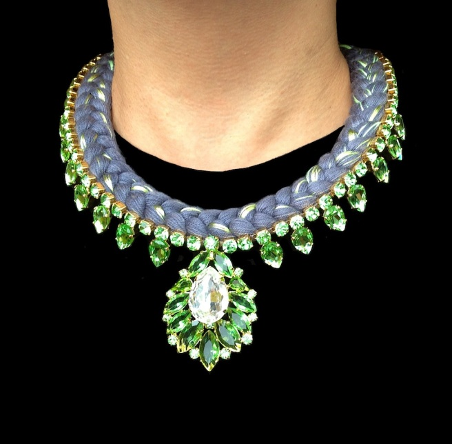 Madrid statement necklace is made with a charcoal silk braid, mixing in a touch of chartreuse The necklace is embellished with beautiful green crystals dipped in gold.