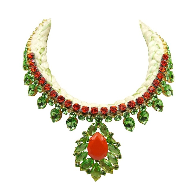 Madrid statement necklace is made with a white silk braid, mixing in a touch of chartreuse silk. The necklace is embellished with a row of small crystals in orange and adorned with a beautiful green crystal necklace dipped in gold.