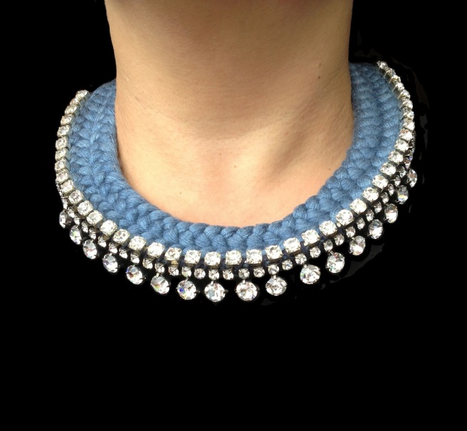 This statement collar is handmade by Jolita Jewellery. The necklace is embellished with three rows of clear crystals and  braided with a double collar charcoal silks, hand-dyed by the designer in his London studio.