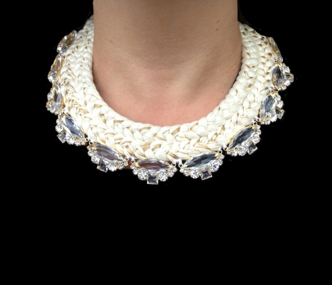 This beautiful Paris statement necklace is made with a white double collar silk braid, mixing in a touch of gold,  and clear crystals dipped in gold for that extra luxury.