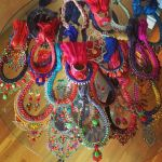 Colourful Jolita Jewellery necklaces, bracelets and earrings all ready for a fashion shoot