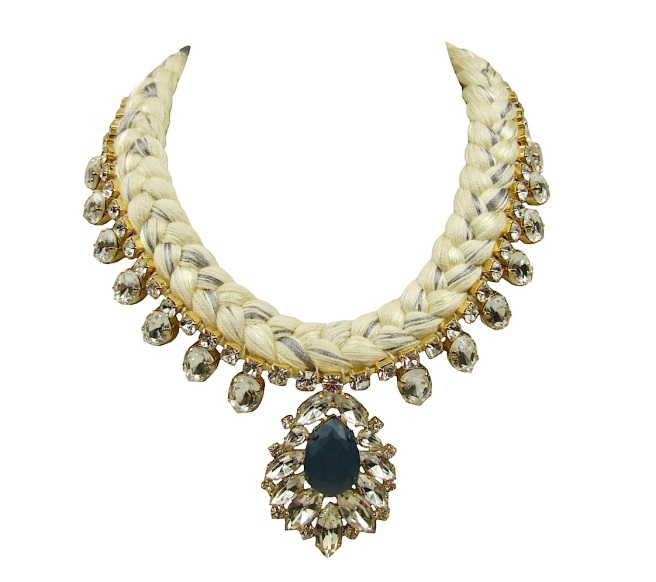 Casablanca statement necklace is made with a white silk braid, mixing in a touch of metallic grey. The necklace is adorned with beautiful clear crystals dipped in gold, with the centre stone hand-painted in beautiful dark teal colour.