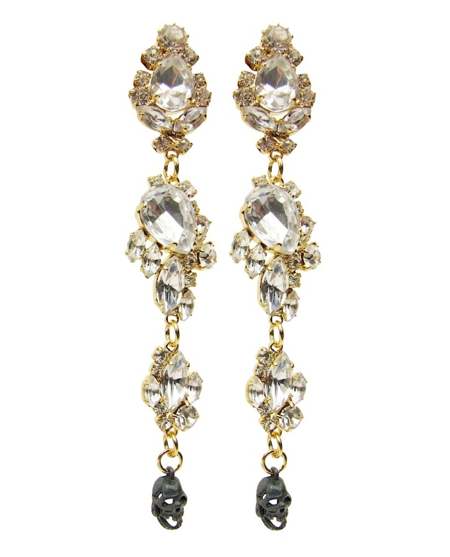 "Luxury Duchess statement earrings by Jolita Jewellery, made with deconstructed clear crystals dipped in gold and embellished with ""moving jaw"" skull made of oxidised sterling silver. The earrings are made for pierced ears."