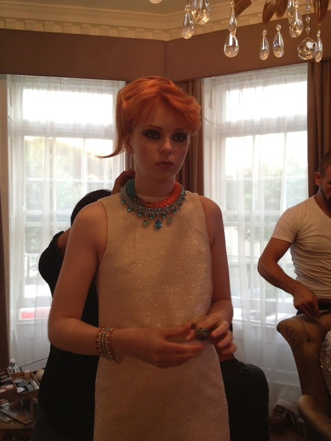 From recent fashion shoot - a model is getting ready for the next shot. Wearing Jolita Jewellery Capri necklace in a dip-dyed orange and turquoise silk braid and aquamarine crystals dipped in gold.