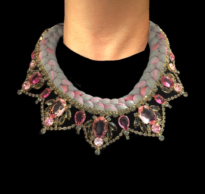 A beautiful hand-made statement necklace made with dipped in gold smokey quartz and pink crystals and silk braid in soft grey, mixing in a touch of pink.