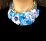 Luxury Windsor statement necklace by Jolita Jewellery, made with a soft grey silk braid, beautiful hand-made blue, red, pink silk flowers and adorned with small luxury bugs dipped in gold and a beautiful aquamarine blue rhinestones boutonnière, dipped in gold.