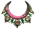 A bright colourful St.Tropez statement necklace by Jolita Jewellery, made with dipped in gold pink and emerald green crystals and dip-dyed silk braid in black with a splash of fuchsia pink, hand-dyed in our studio.