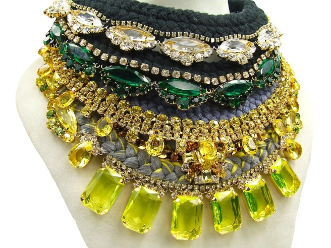A selection of hand-made statement necklaces created by Jolita Jewellery mixing together silk and crystals.