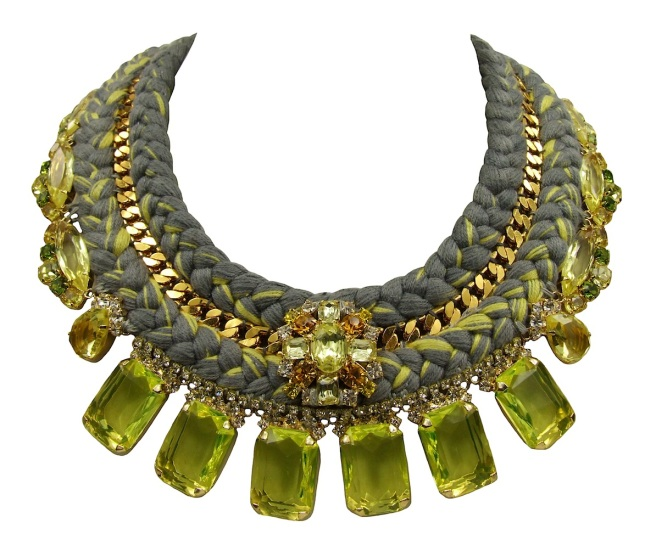 A new version of luxury Portofino statement necklace, made with a double collar light charcoal silk braid, mixing in a touch of citrine yellow. The collar is embellished with a gold-plated chain, intricately hand-stitched between the two silk braids. The necklace is adorned with an array of luxury deconstructed jewels, dipped in gold, including a luxury boutonniere, positioned at the centre of the braid.