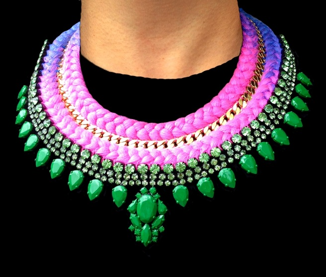 This colourful statement necklace is a part of Jolita Jewellery luxury collection, made with a double collar dip-dyed silk braid gradually changing from purple to bright fuchsia pink, hand-dyed in our London studio. The silk braid is adorned with a gold-plated chain, intricately hand-stitched between the two braids, and hand-painted in green crystal necklace. A beautiful colourful statement necklace.