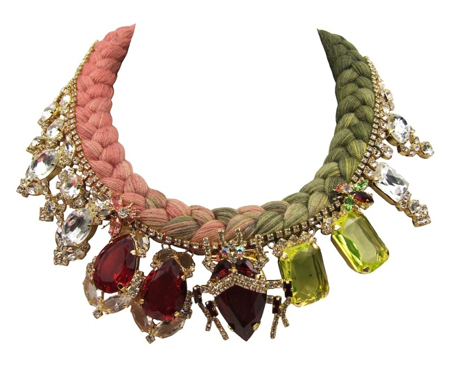 A luxury statement necklace made with a dip-dyed peach and olive braid and an array of deconstructed jewels, dipped in gold