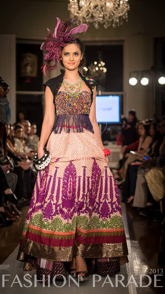 Fashion Parade event, supporting Save The Children charity. A catwalk with Nomi Ansari design and hand-painted Carnival statement necklace with a crimson braided cuff, both by Jolita Jewellery.