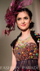 Fashion Parade event, supporting Save The Children charity. A catwalk with Nomi Ansari design and hand-painted Carnival statement necklace by Jolita Jewellery.