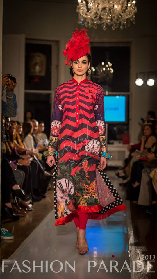 Fashion Parade event, supporting Save The Children charity. A catwalk with Nomi Ansari design and two statement bangles  by Jolita Jewellery.
