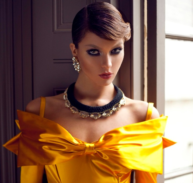 From a fashion shoot - in a beautiful Katayoon Haute Couture dress and Jolita Jewellery's luxury Madrid statement earrings and Paris Luxe necklace in a black double collar silk braid and clear crystals