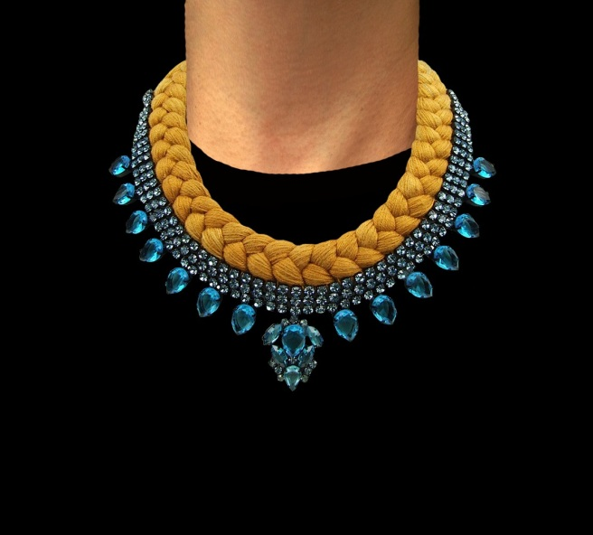Santorini statement necklace designed by Jolita Jewellery with aquamarine crystals and sand brown silk braid, gradually changing to turquoise at the back of the necklace, hand-dyed by the designer in his London studio.