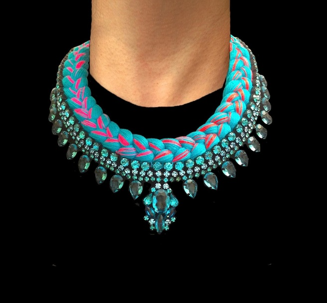 Santorini statement necklace designed by Jolita Jewellery with aquamarine crystals and turquoise silk braid, mixing in a touch of scarlet red, gradually changing to fuchsia pink, hand-dyed by the designer in his London studio.