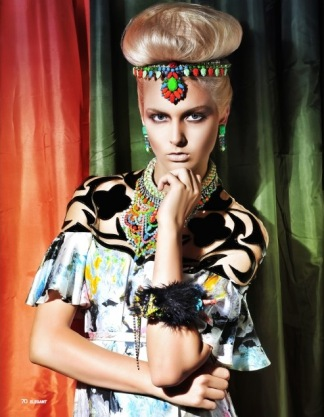 Elegant Magazine, December 2013 - Dreamy Jewellery editorial featuring Jolita Jewellery. A model is wearing colourful Dubai earrings hand-painted and covered in silk. Madrid Luxe statement necklace styled as a head-piece, Tribal Couture statement bangle and Carnival and Monaco necklaces.