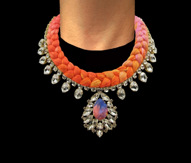 Casablanca statement necklace is made in a multicoloured silk braid, gradually changing from fuchsia to yellow, bright orange and salmon red. The necklace is adorned with beautiful clear crystals dipped in gold, the centre stone is covered in a hand-dyed silk.
