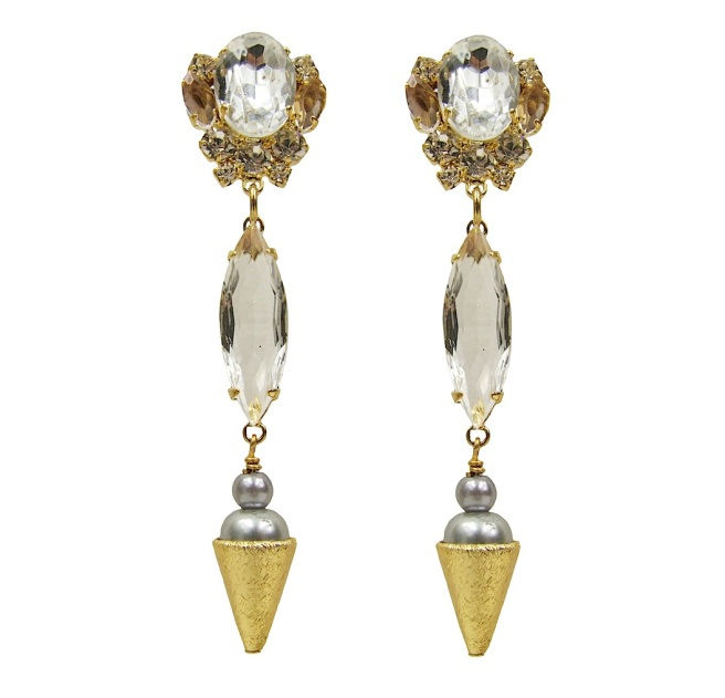 Debutante earrings by Jolita Jewellery, made with clear crystals. Each earring is embellished with elongated oval clear crystal and a silver faux pearl, sitting in a gold-plated cone. Earrings are dipped in gold for luxurious finish.