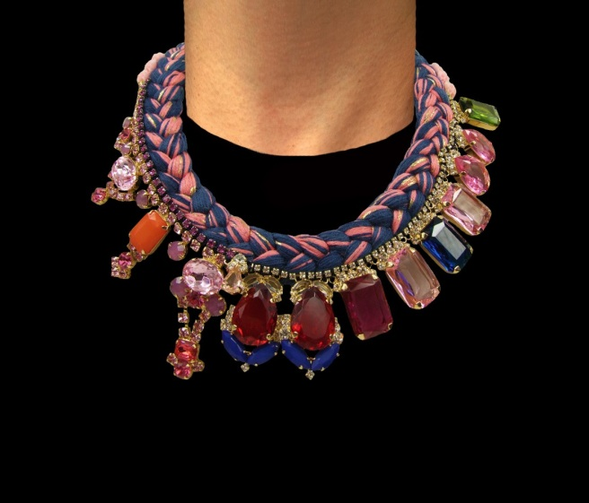 Luxury Geneva statement necklace made with a blue silk braid, mixing a touch of pink, hand-dyed in our studio. The silk is adorned with an array of deconstructed jewels dipped in gold.