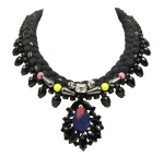 Venice statement necklace is made with a black silk braid, mixing in a touch of gold. The necklace is adorned with beautiful black crystals, with the centre stone covered in hand-dyed silk. The silk braid is embellished with colourful Swarovski crystals, semi-precious stones and two ruthenium plated skulls.