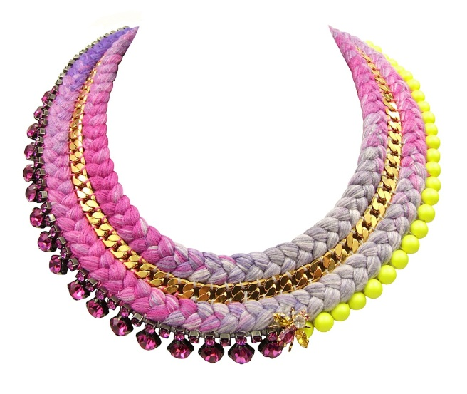 This colourful Chelsea statement necklace is a part of Jolita Jewellery luxury collection, made with a double collar multicoloured silk braid gradually changing from purple to bright fuchsia to grey, fuchsia and purple, hand-dyed in our London studio. The silk braid is adorned with a gold-plated chain, intricately hand-stitched between the two braids, fuchsia pink Swarovski crystals and Swarovski neon pearls.
