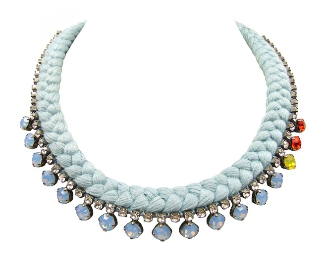 This beautiful handmade statement necklace by Jolita Jewellery is made with powder blue silk braid and opaque blue Swarovski crystals, mixing in a few yellow and orange stones.