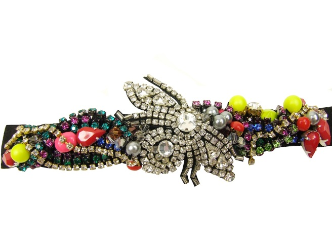 Crystal bracelet by Jolita Jewellery from Kaleidoscope collection. The bracelet is made mixing various colourful crystals, neon Swarovski pearls, and embellished with a crystal bug.