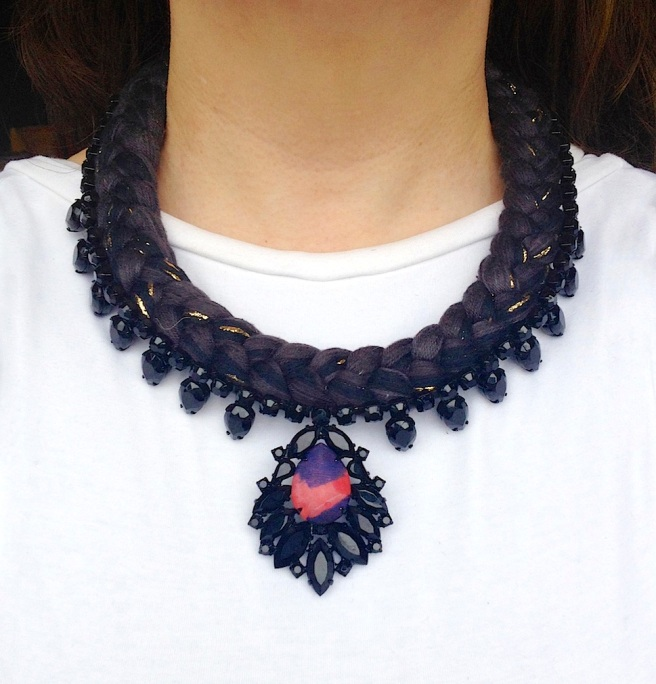 Venice statement necklace is made with a black silk braid, mixing in a touch of gold. The necklace is adorned with beautiful black crystals, with the centre stone covered in hand-dyed silk.
