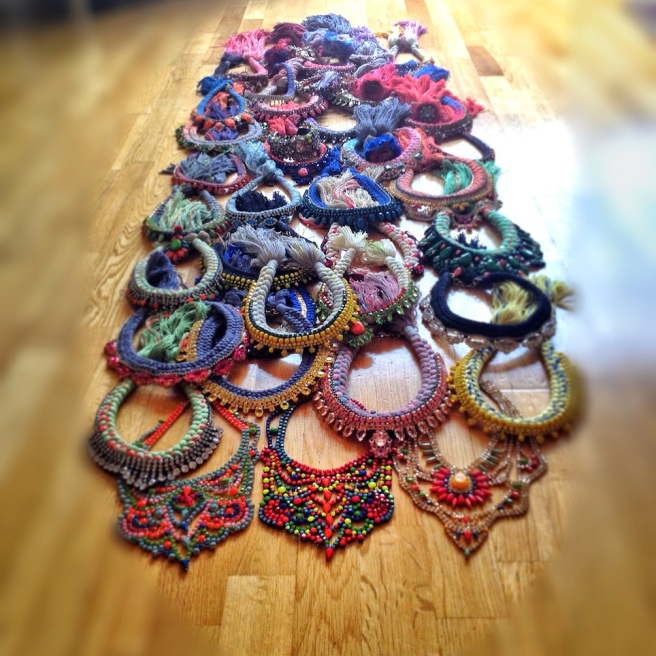 Colourful Jolita Jewellery statement necklaces and cuffs are ready to be packed for a shoot