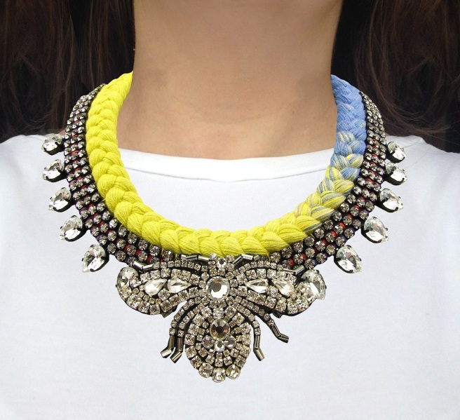Maldives Luxe statement necklace designed by Jolita Jewellery with clear crystals and dip-dyed silk braid in yellow and blue, hand-dyed by designer in his London studio.The necklace is adorned with a hand-maded rhinestone bug.