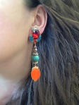 Colourful statement earrings by Jolita Jewellery made with dipped in gold crystals, skulls, turquoise stone and silk.