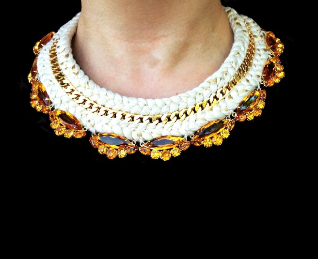 This beautiful statement necklace is a part of Jolita Jewellery luxury collection, made with a double collar nude silk braid, hand-dyed in our London studio. The silk braid is adorned with a gold-plated chain, intricately hand-stitched between the two braids, and amber crystals, dipped in gold. A beautiful colourful statement necklace.